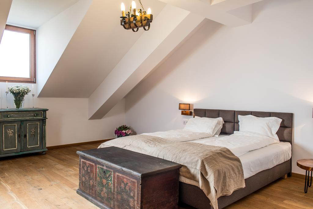 Spacious room with vintage painted furniture at a refurbished mansion in Transylvania